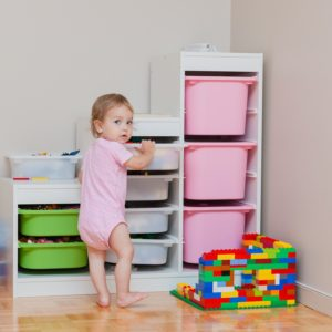 Child and Toy Bins