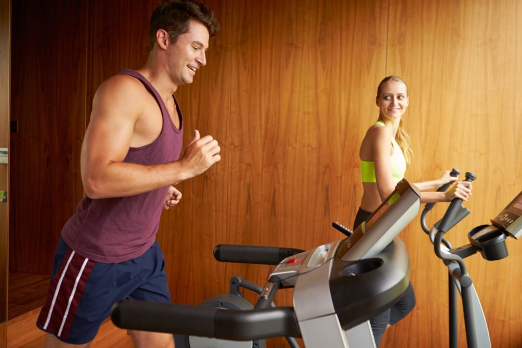 Couple on a treadmill at home
