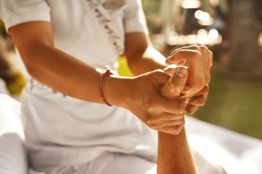 Massage therapist using essential oils
