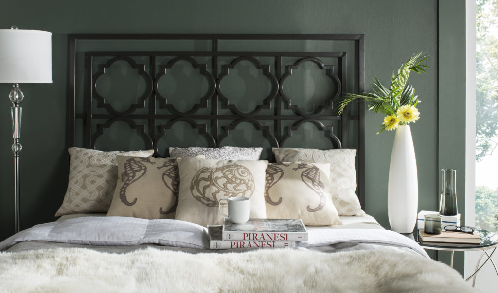 A Queen sized, Gun metal colored, metal headboard with a Quarterfoil design.