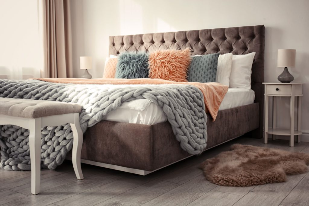 Mattress in upholstered bed