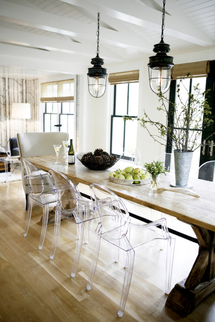 Ghost-chairs-at-rustic-wood-dining-table